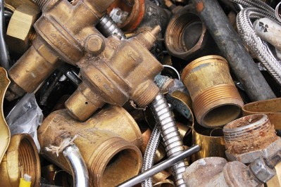 Different Types Scrap Metals Sorted into Piles for Efficient Rec